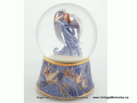 Angel with dove water globe
