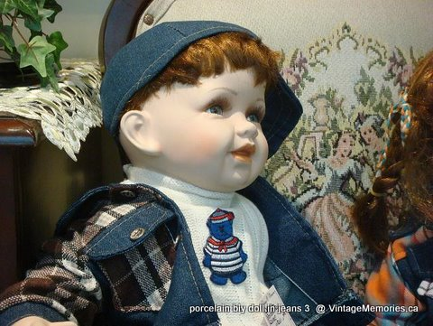Porcelain boy doll in jeans