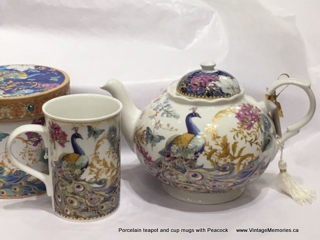 Porcelain teapot and cup mugs with Peacock