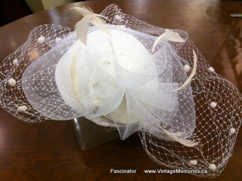 Feather fascinator and hair clips for wedding