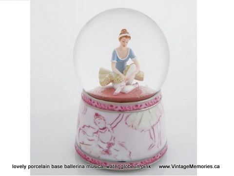 lovely porcelain base ballerina musical water globe in pink